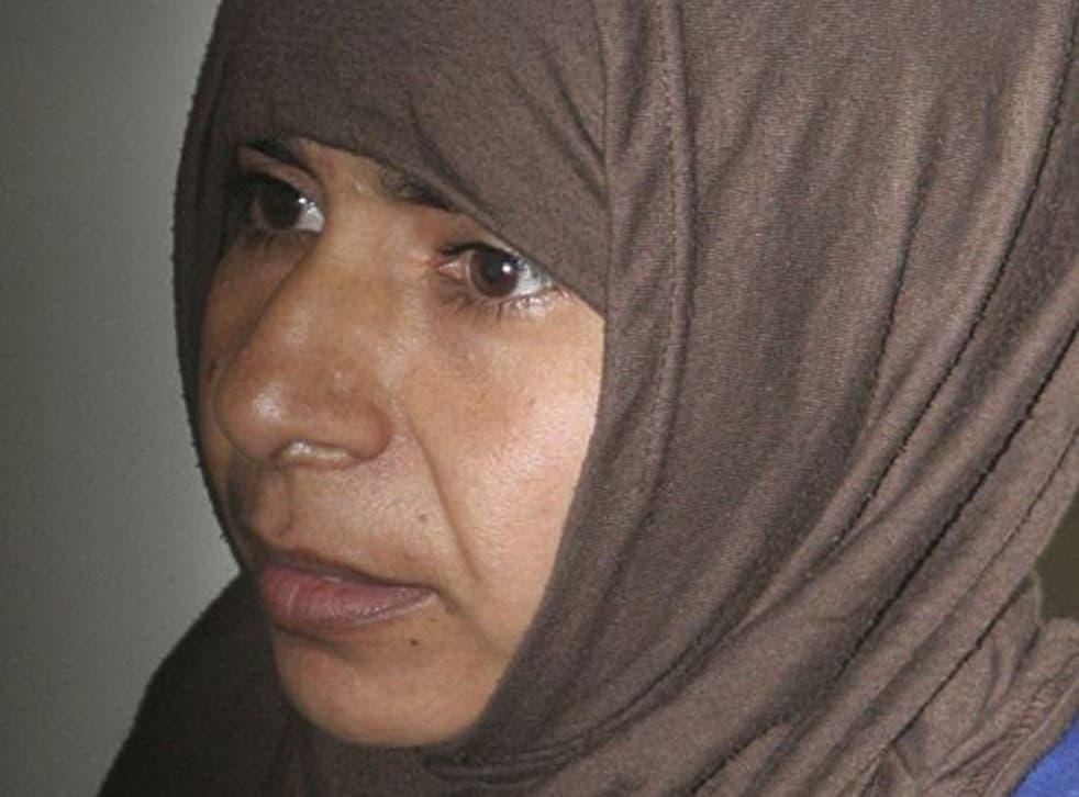Iraqi Sajida al-Rishawi, 35, stands inside a military court at Juwaida prison in Amman in this April 24, 2006 file photo.