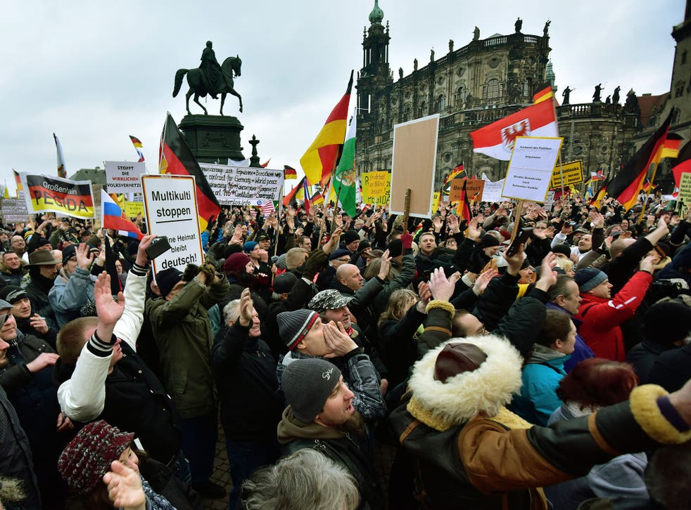 Supporters of the Pegida movement pictured during their weekly demonstration last month
