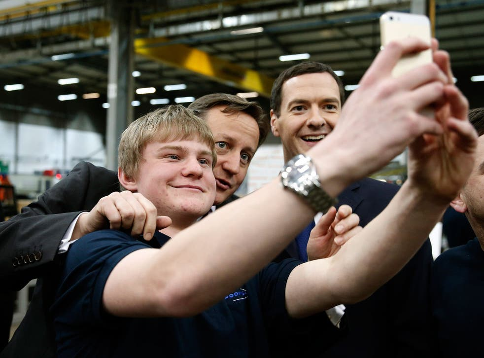 Prime Minister David Cameron and Chancellor of the Exchequer George Osborne pose for a selfie photograph with an apprentice during a visit to the Spooner engineering works in Ilkley