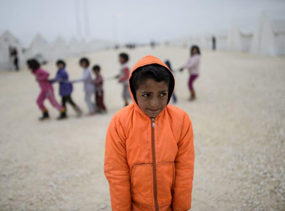 A young Syrian Kurdish refugee at a UNHCR camp in Suruc, Turkey