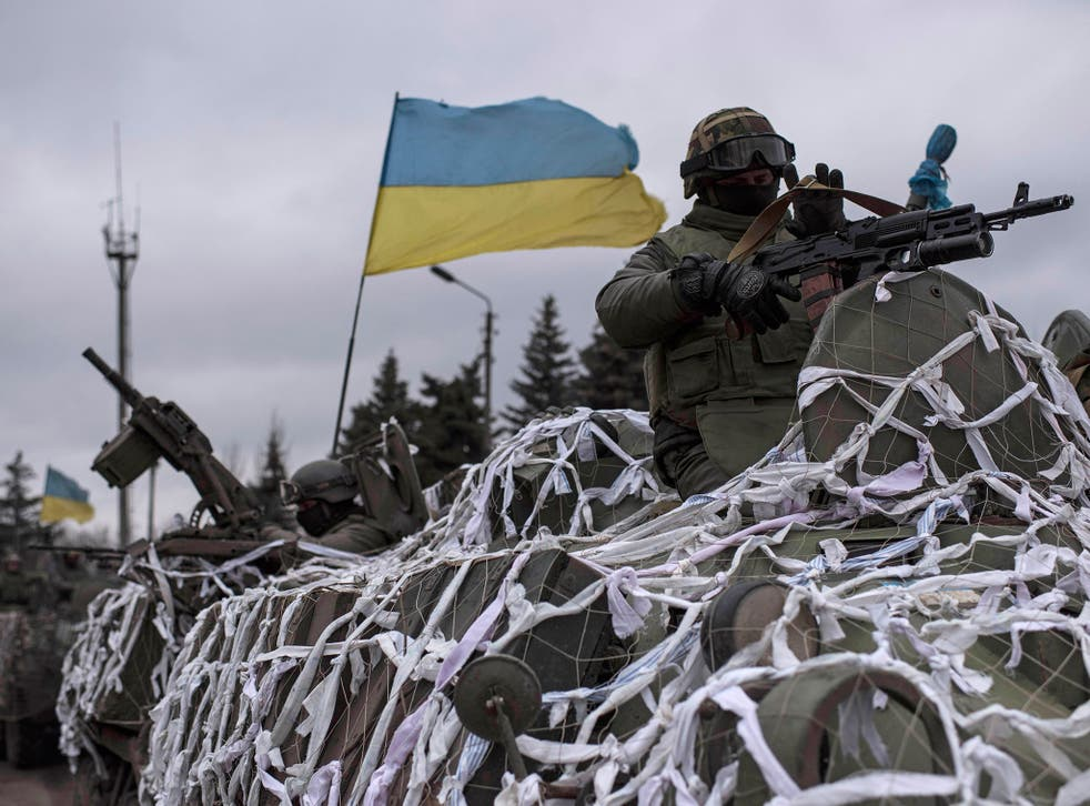 Ukrainian military defend the government-held town of Debaltseve from Russian-armed rebels