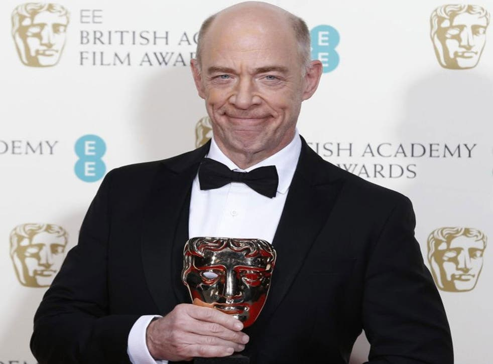 """J.K. Simmons celebrates after winning best supporting actor for """"Whiplash"""" at the BAFTA awards ceremony"""