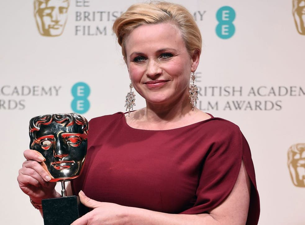 US actress Patricia Arquette poses in the press room after winning the Best Supporting Actress award for her performance in 'Boyhood' during the BAFTAs