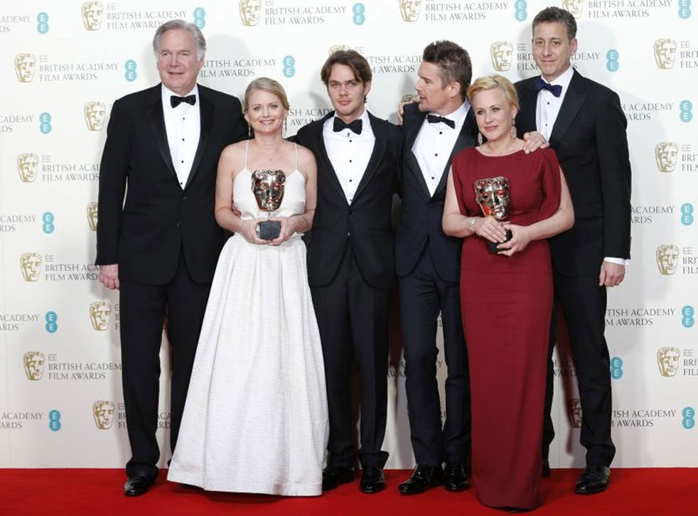 (Left to right) Jonathan Sehring, Cathleen Sutherland, Ellar Coltrane, Ethan Hawke, Patricia Arquette and John Sloss celebrate after winning the best film award for Boyhood at the Baftas