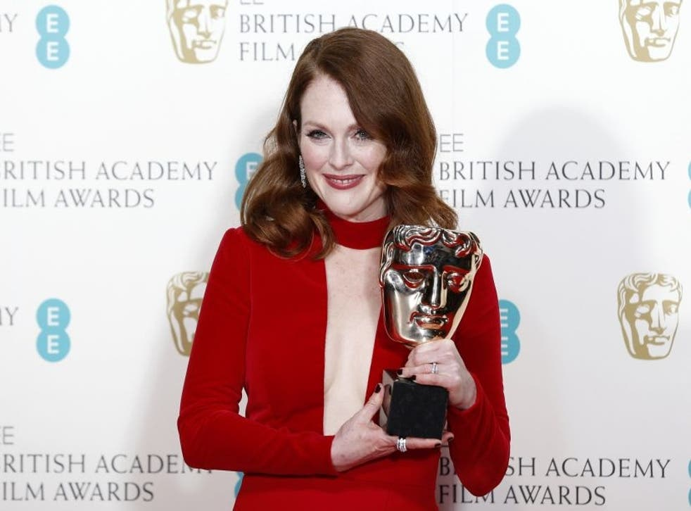 """Actress Julianne Moore poses after receiving the award for best leading actress for """"Still Alice"""""""