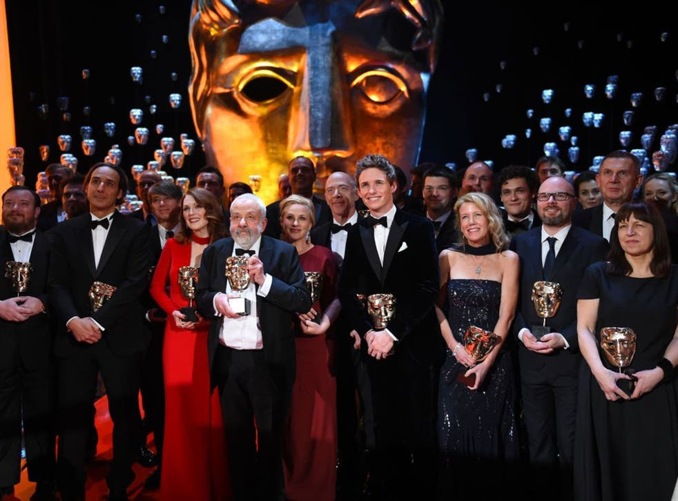 Winners pose on the stage during the Baftas