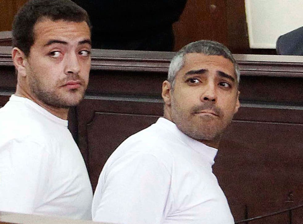 Al-Jazeera English producer Baher Mohamed, left, and  Canadian-Egyptian acting Cairo bureau chief Mohammed Fahmy, right, during their previous appearance in court
