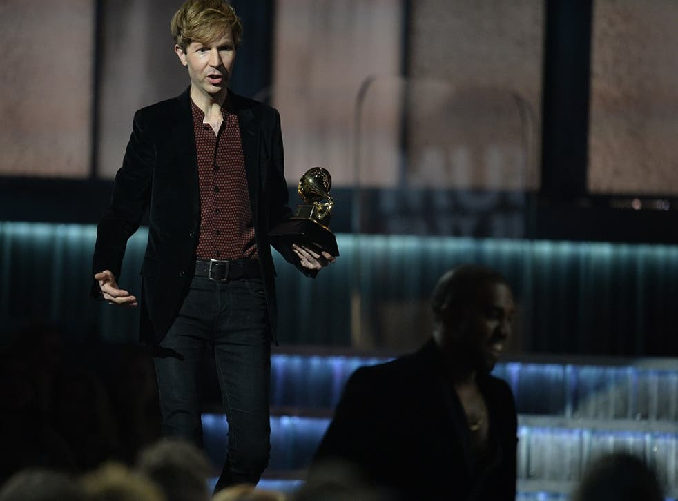 Album of the Year winner Beck jests with Kanye West  after the rapper poked fun at the previous controversy over his Taylor Swift interjection by jumping up during Beck's speech