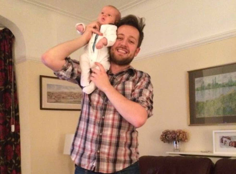 Baby bond: writer Will Dean at home with his newborn baby, Johnny