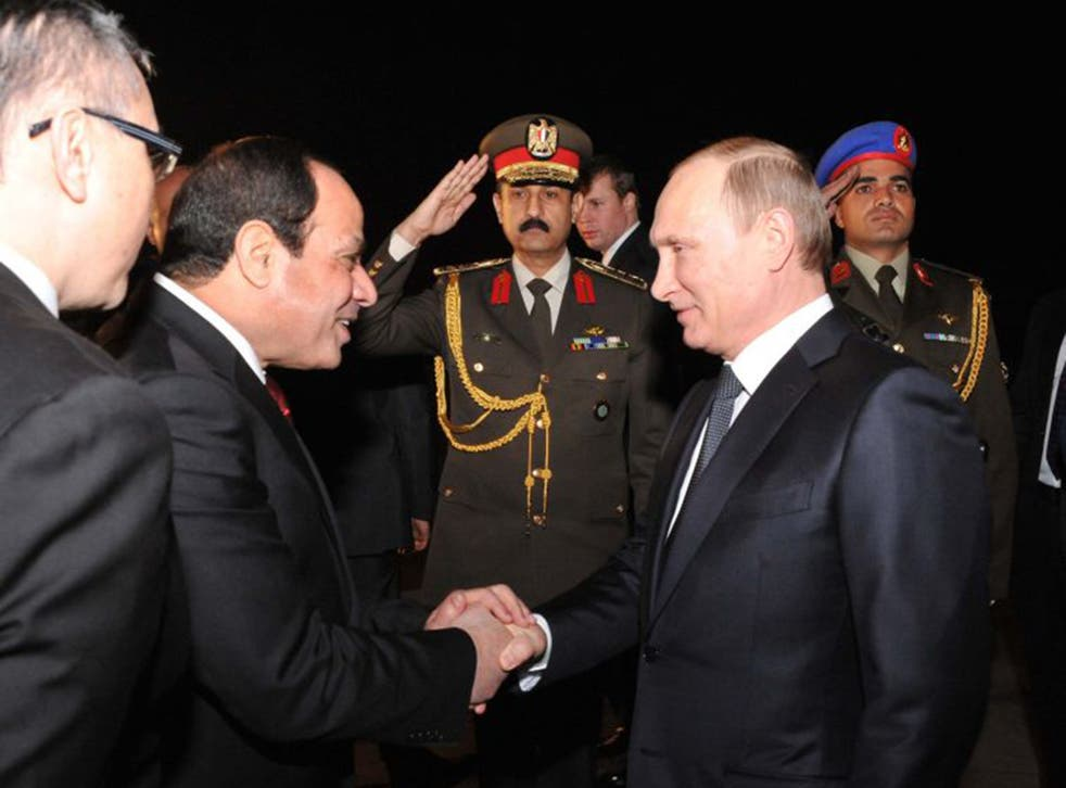 President Sisi welcomes Vladimir Putin to Cairo on Monday night