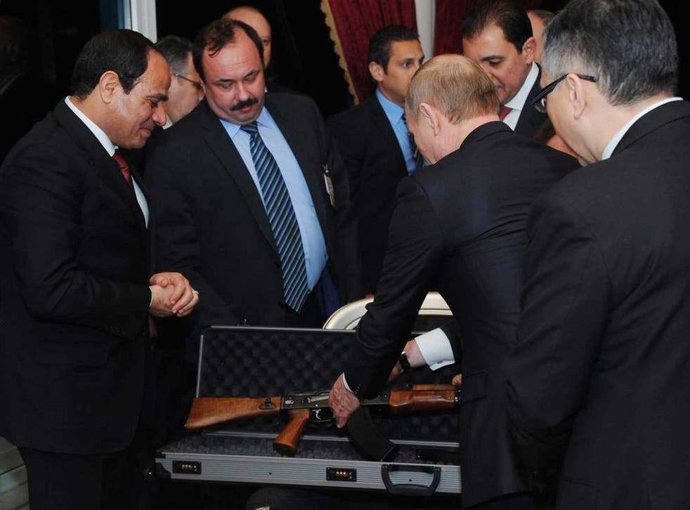 Al-Sisi positively glows with happiness as Putin presents the deadly rifle