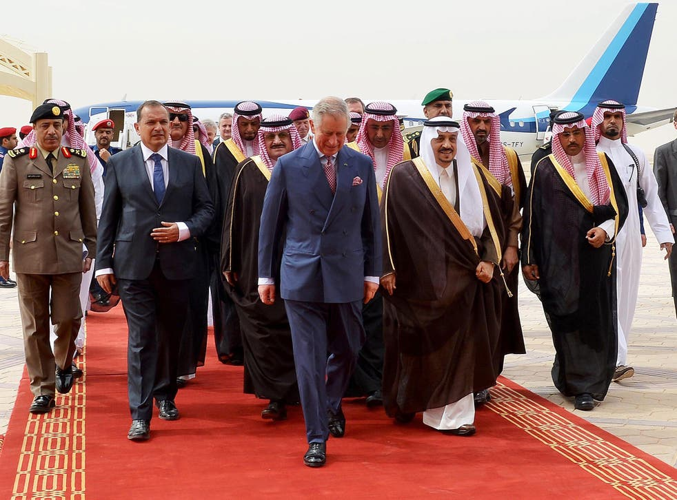 Prince Charles (center - L) being welcomed by the Governor of Riyadh Province, Turki bin Abdullah al-Saud (center - R), upon his arrival at the airport in Riyadh, Saudi Arabia