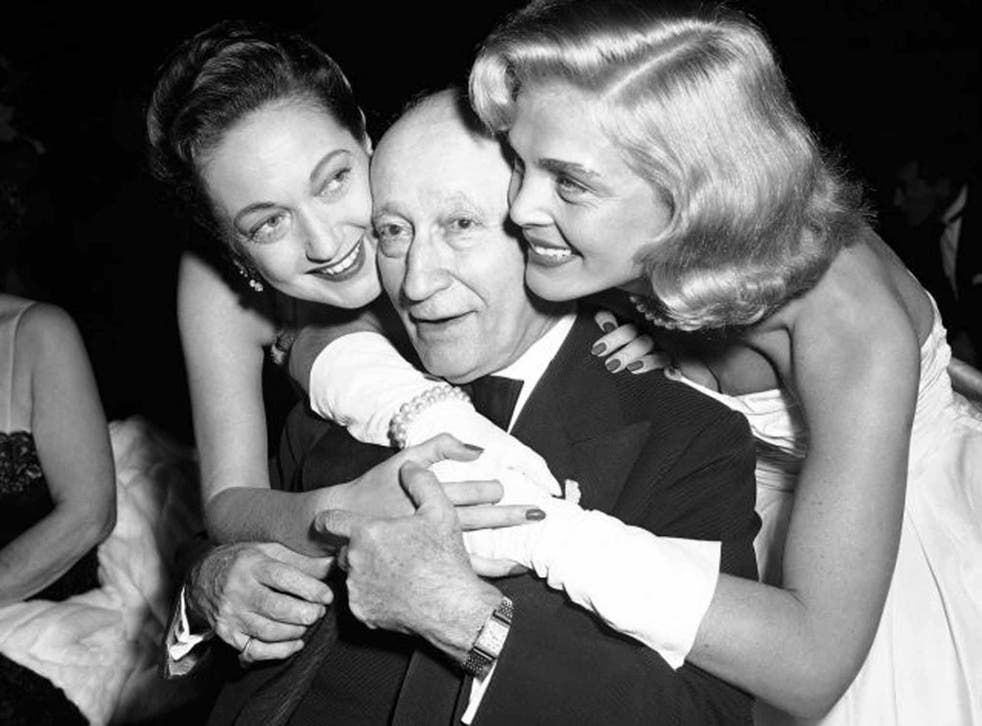 Scott, right, with Dorothy Lamour, gives a birthday hug to the head of Paramount, Adolph Zukor, at an industry dinner in 1953
