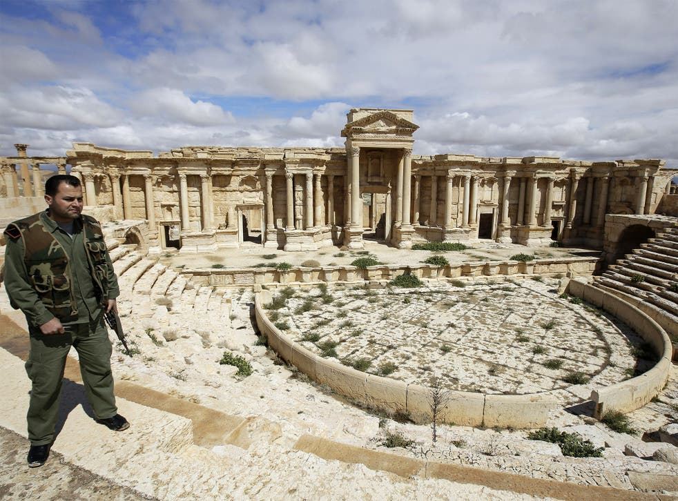 A Syrian police officer patrols the ancient city of Palmyra
