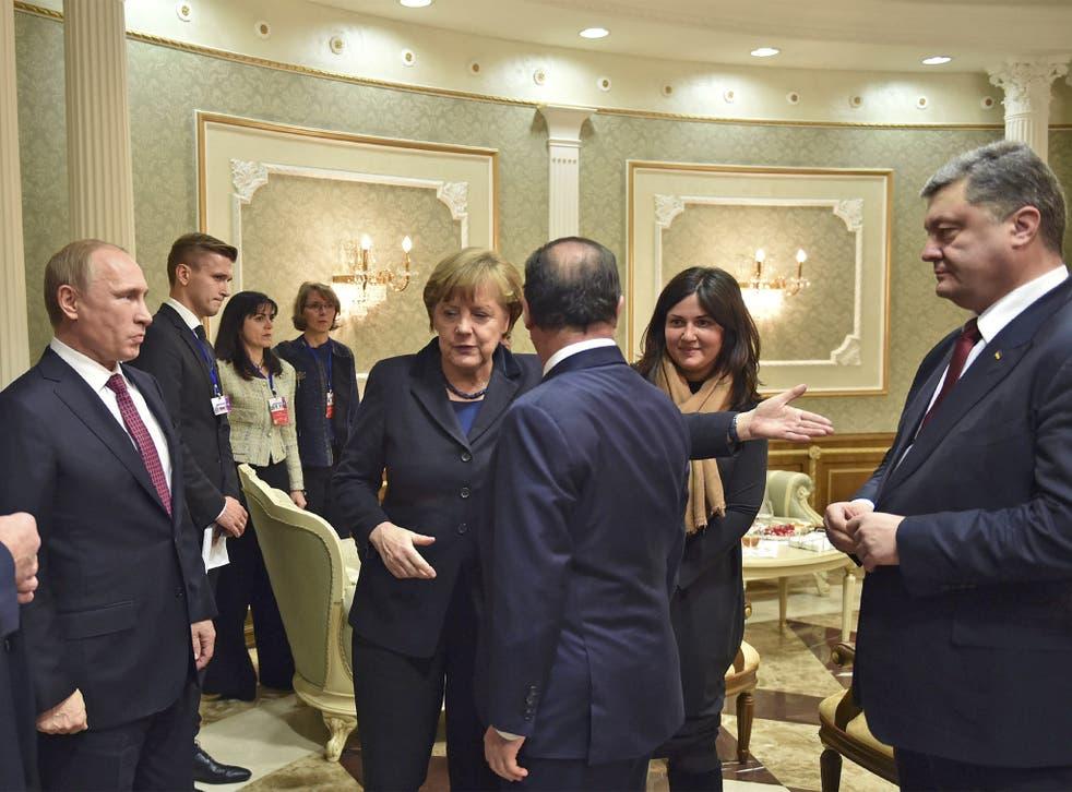 From left: Vladimir Putin, Angela Merkel, François Hollande and Petro Poroshenko in the Belarusian capital on Wednesday night before talks about the violence in Ukraine