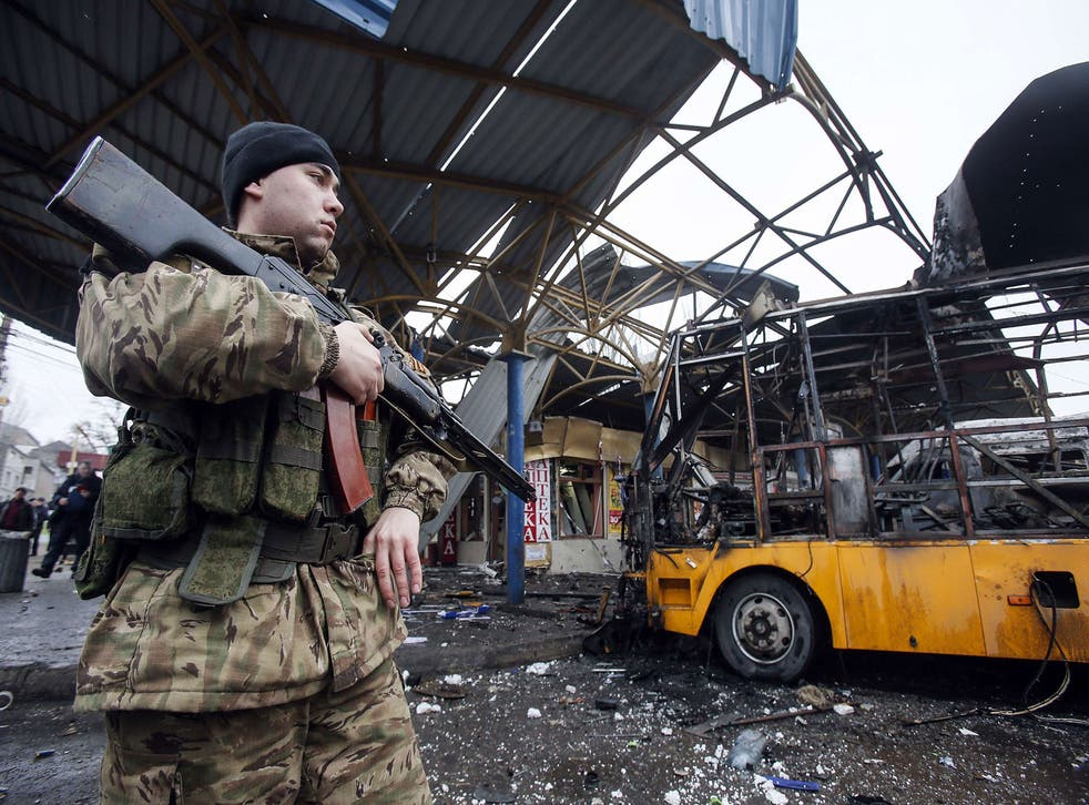 A soldier of the self-proclaimed Donetsk People's Republic, where shelling killed at least one on Tuesday