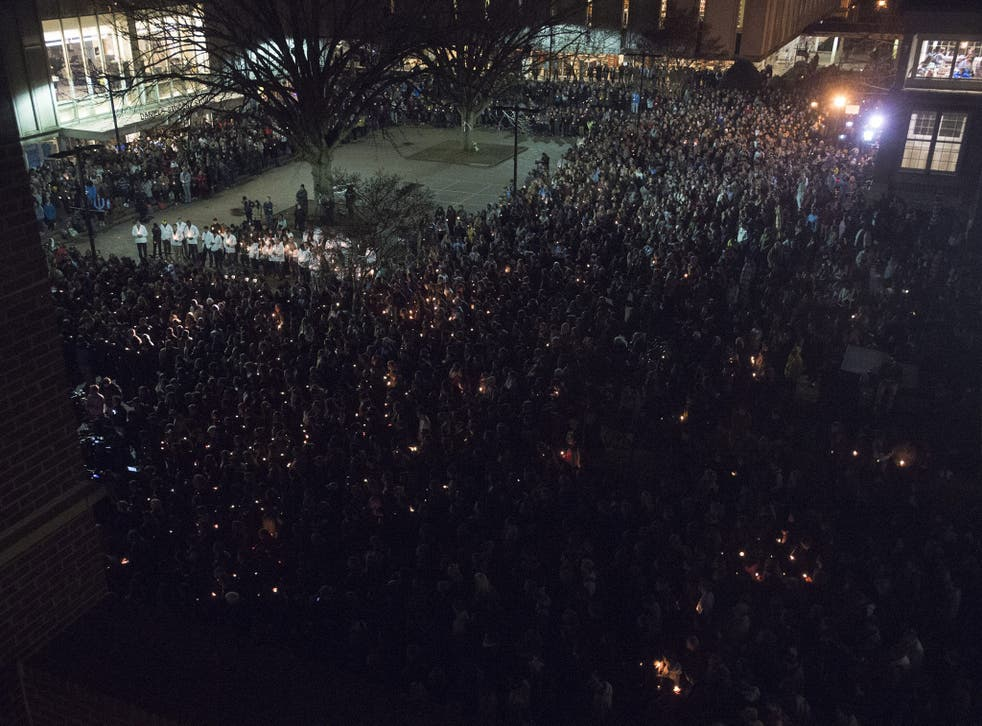 A vigil at 'The Pit' on the campus of the University of North Carolina in memory of Deah Shaddy Barakat, Yusor Mohammad Abu-Salha, and Razan Mohammad Abu-Salha