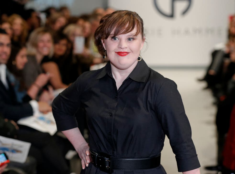 Jamie Brewer working the New York Fashion Week catwalk.