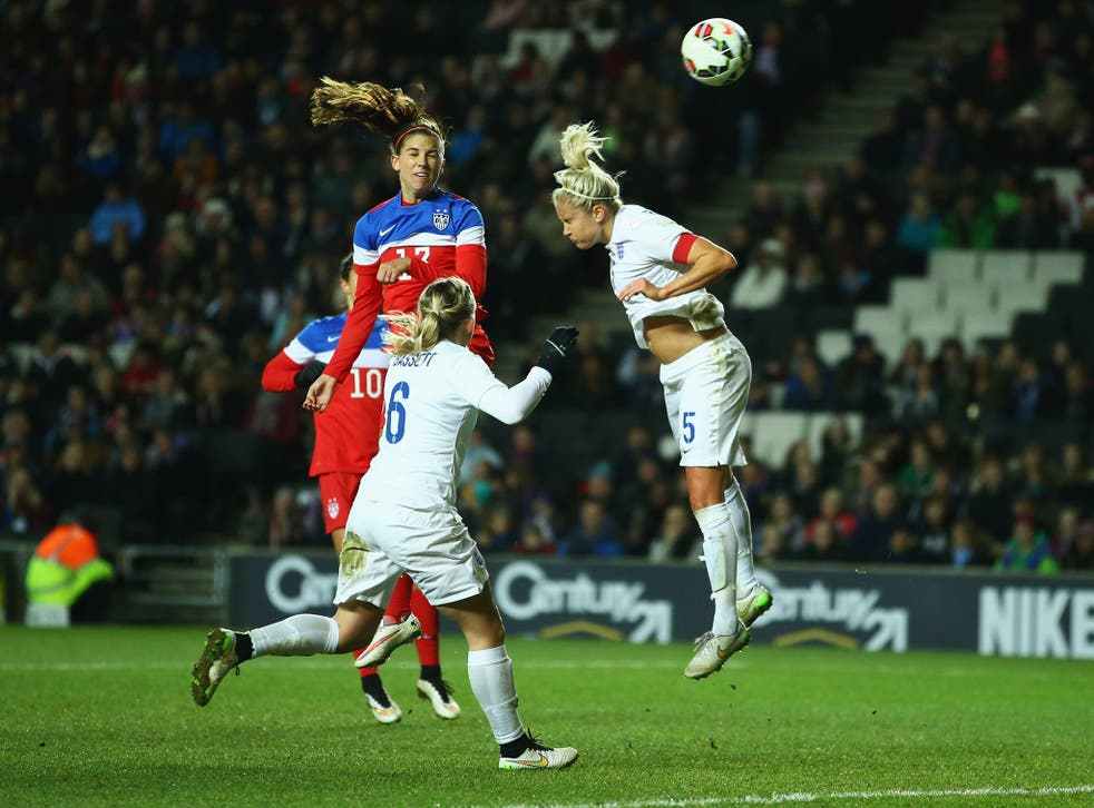 Alex Morgan rises above the England defence to score the only goal of the game