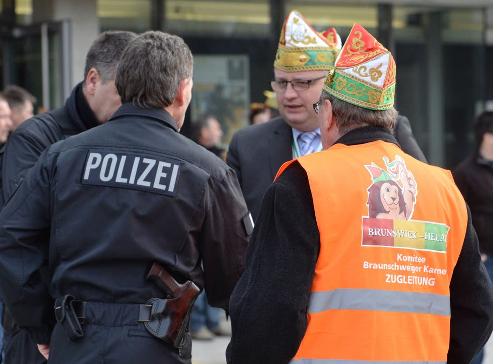Carnival parade organizers and police discuss in Braunschweig, Germany, Sunday, Feb. 15, 2015. Police in Braunschweig cancelled a popular carnival street parade because of fears of an imminent Islamist terror attack.