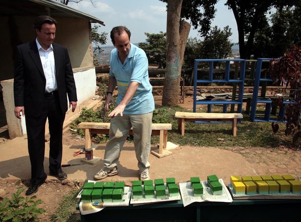 David Cameron, then Leader of the Opposition, during a visit to an orphanage in Rwanda, in 2007. He has repeatedly spoken of his pride that his government has boosted spending on foreign aid