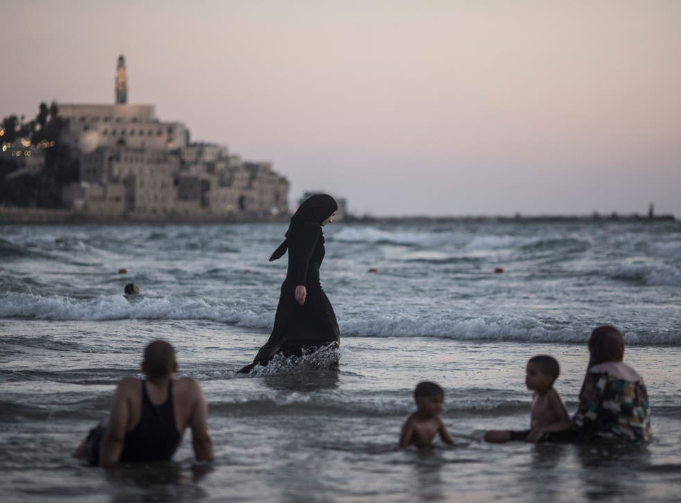 Arab Muslims splash around in the Mediterranean near Tel Aviv, Israel. The pact means that Israeli Arabs could hold the balance of power after next month's election