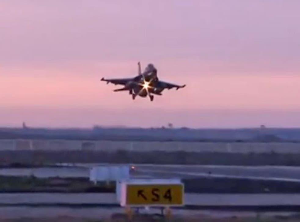 An Egyptian fighter jet returns from bombing Libya