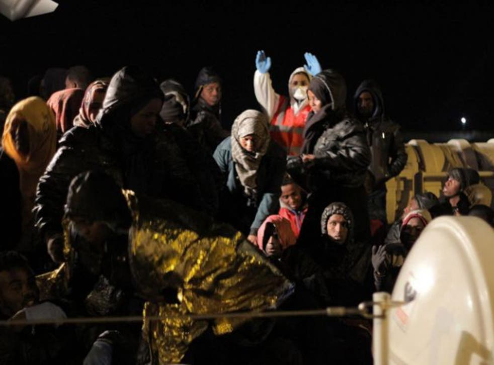 Migrants rescued by the Italian coastguard disembarking in Agrigento province, Sicily, on Monday