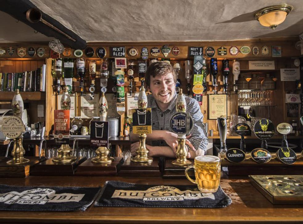 Peter Tiley tends the bar at The Salutation in Ham, Gloucester-shire
