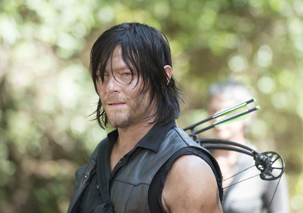 Norman Reedus Bitten By A Walking Dead Fan At The Walker Stalker
