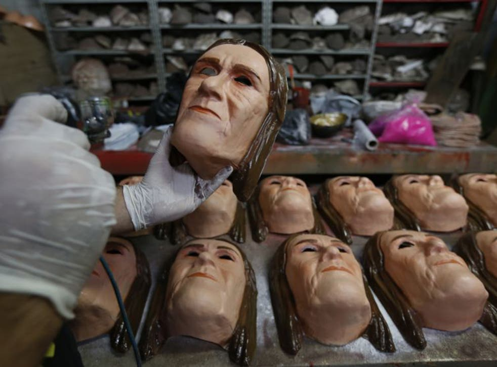 Masks of Maria das Graças Silva Foster, former Petrobras CEO, being prepared for the Rio Carnival, reflecting the high public profile of the unfolding scandal