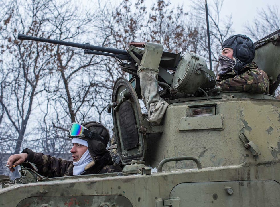 Ukrainian soldiers prepare to drive in the direction of the embattled town of Debaltseve on 16 February