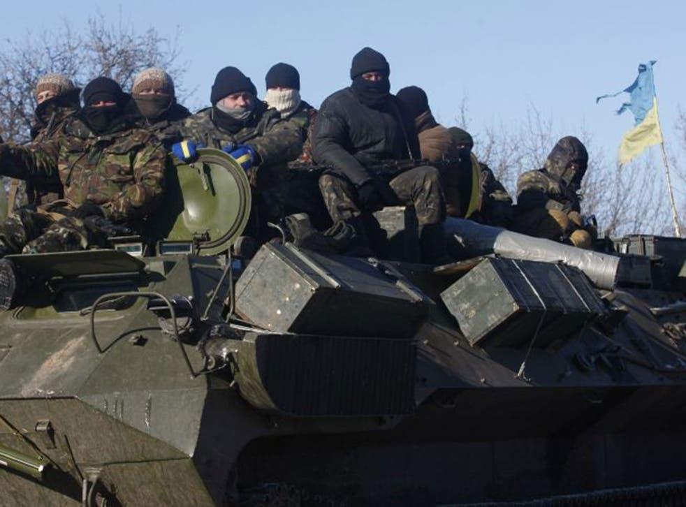 Ukrainian servicemen ride on the way from Artemivsk to Debaltseve on 17 February