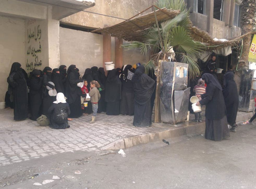 Women living under Isis gather in Raqqa to collect food