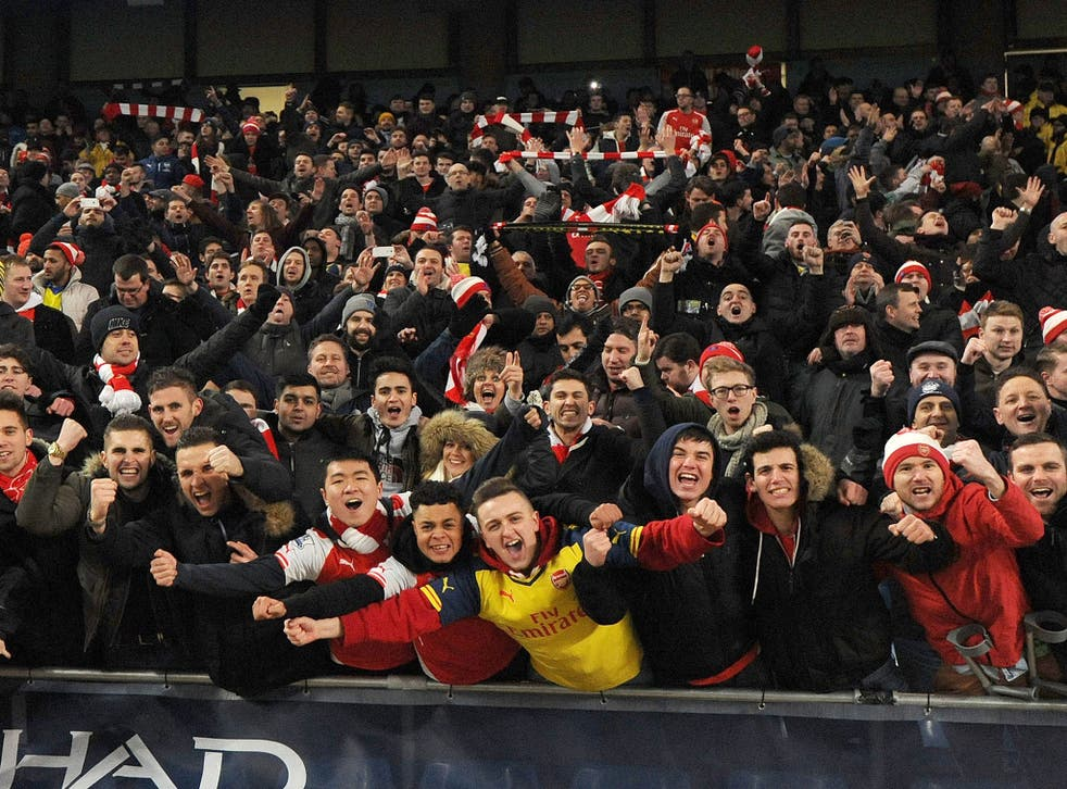 Arsenal supporters celebrate the win over Manchester United's rivals, Manchester City, at the Etihad Stadium back in January