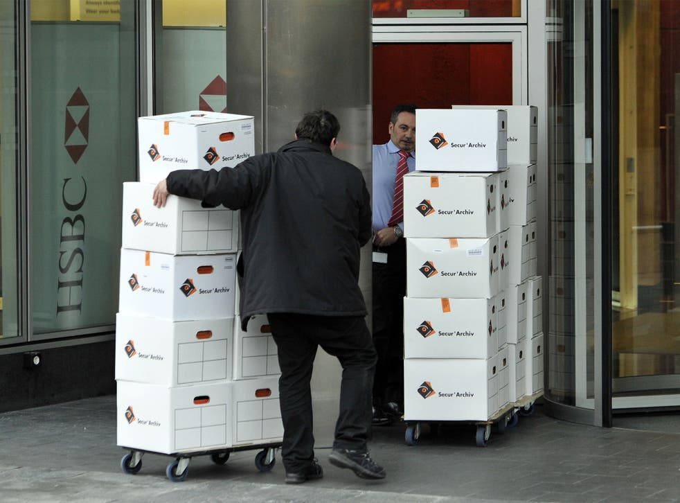 Archives are returned to HSBC premises in Geneva, on the request of Attorney General Olivier Jornot, who oversaw Wednesday's surprise search of the bank