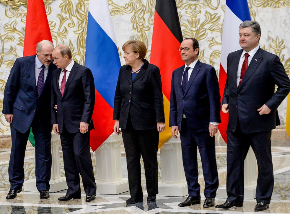 European leaders meet in Minsk and agree on a ceasefire in eastern Ukraine beginning on February 14. From left to right: Belarus President Alexander Lukashenko, Russian President Vladimir Putin, German Chancellor Angela Merkel, France's President Francois