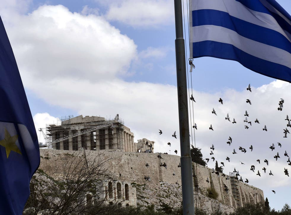 EU and Greek flags fly outside the Acropolis in Athens yesterday, as Greece asked its EU creditors for a six-month bailout extension