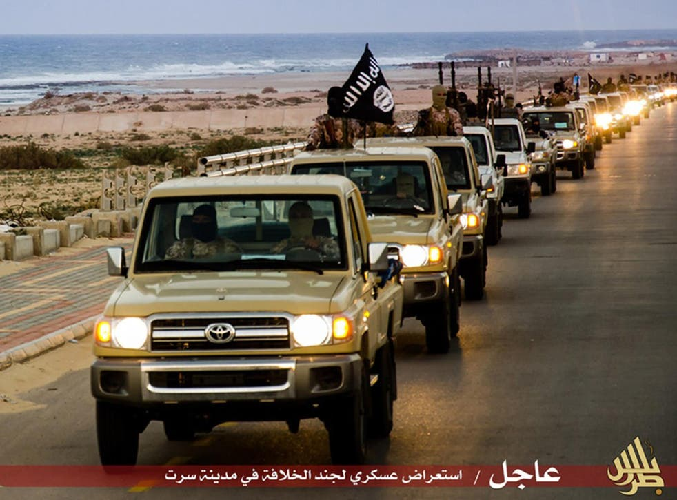 Militants claiming loyalty to Isis have killed dozens with car bombs in eastern Libya