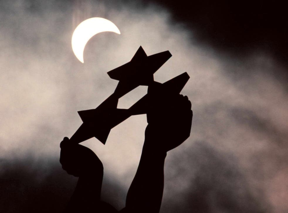 Dark days ahead? The Freedom Monument in Riga during a partial eclipse of the Sun
