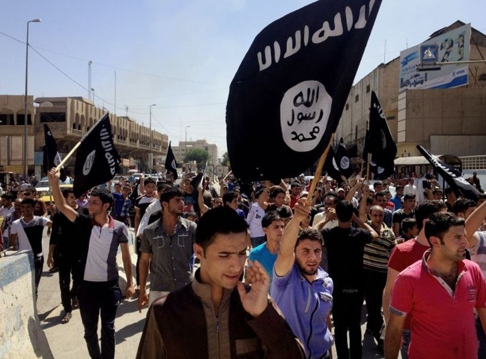 Pro-Islamic State demonstrators in front of the provincial government headquarters in Mosul (EPA)