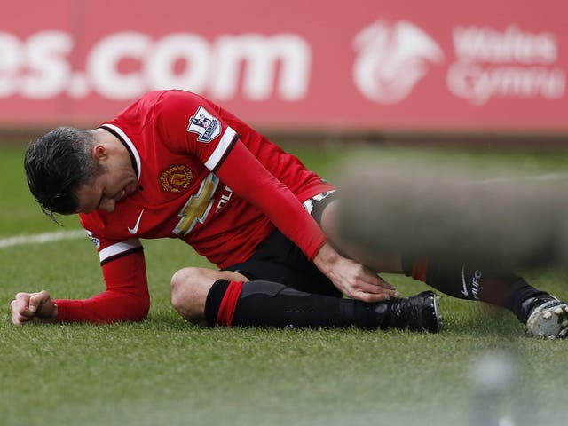 Robin van Persie suffers an ankle injury at the Liberty Stadium