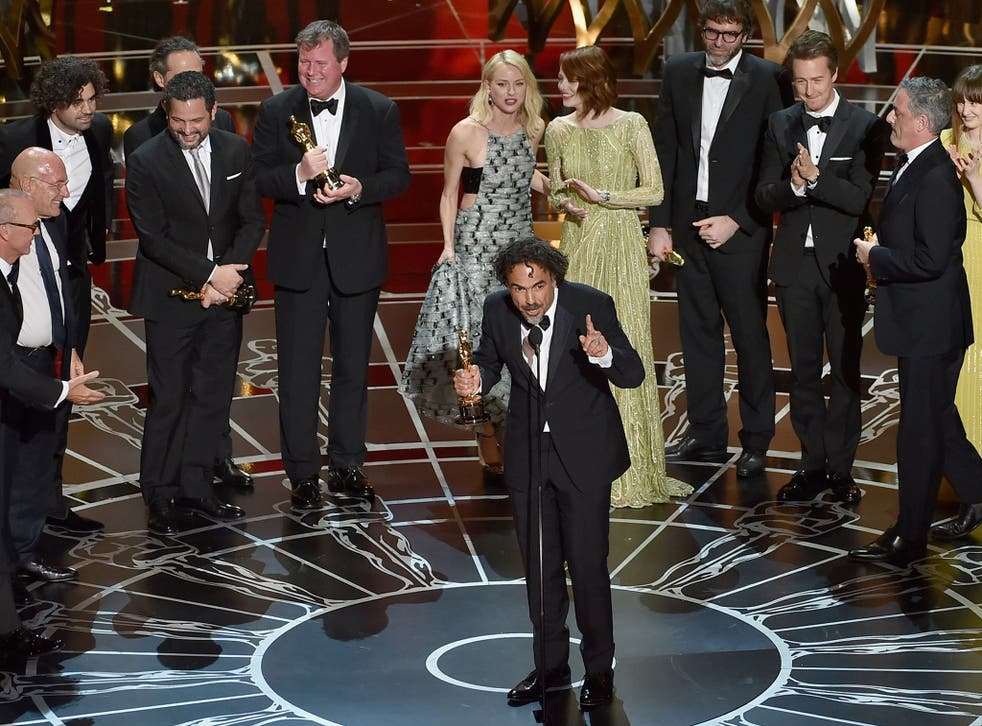 The cast and crew of Birdman accept their Best Picture Oscar on stage