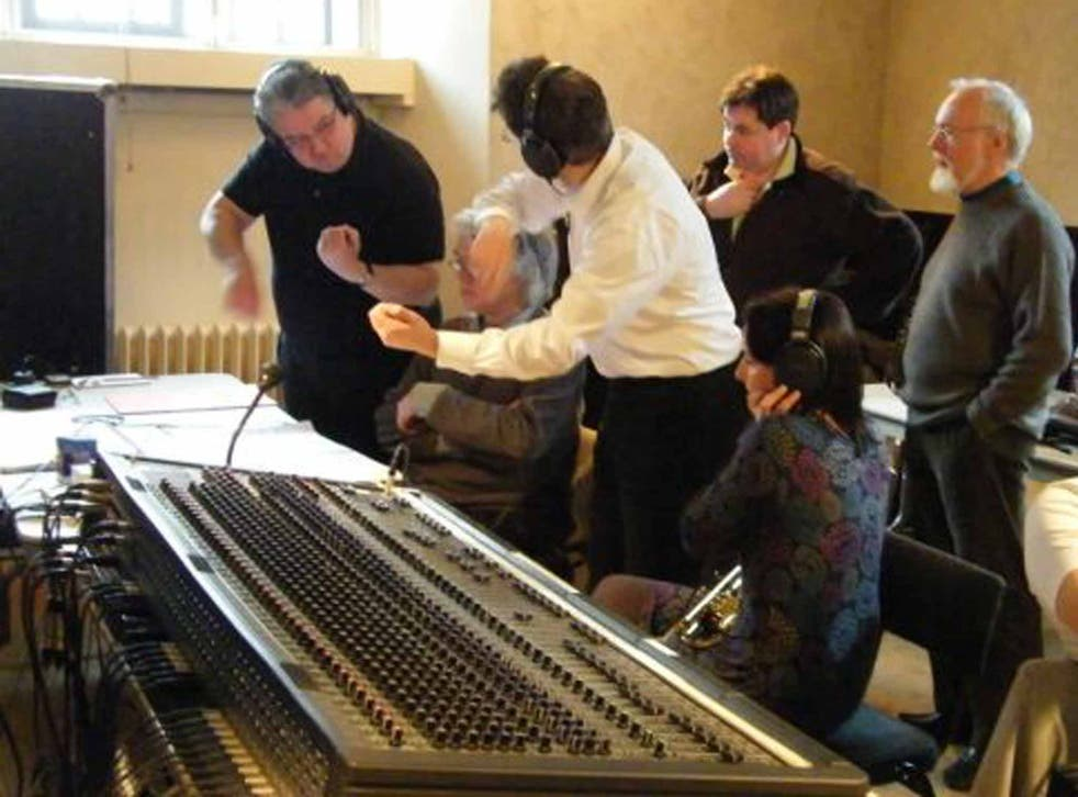 McCabe, far right, oversees a session to record his 'Rainforest II', at the Henry Wood Hall in London