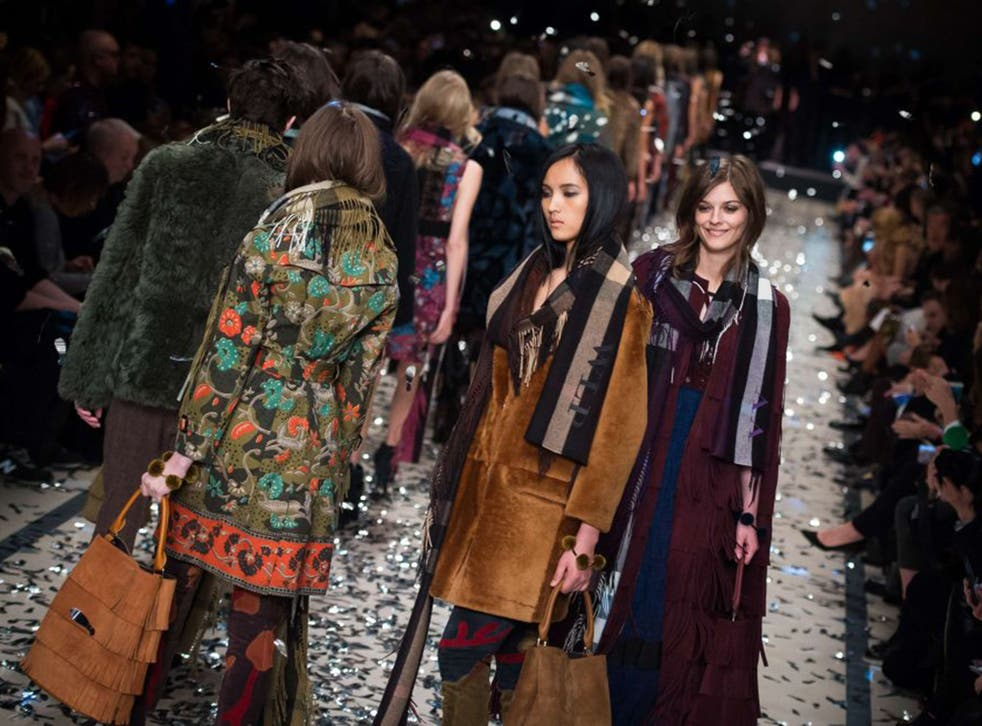 Models wearing clothes from the Burberry Prorsum collection during the company's 2015 autumn/winter London Fashion Week show
