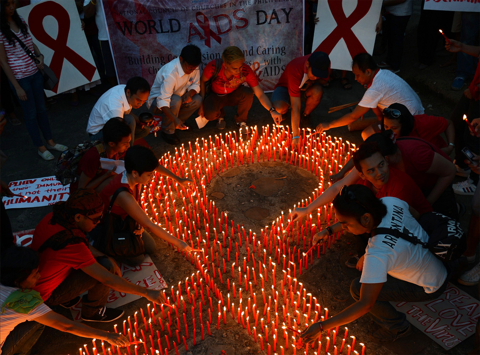 Activists light candles on World Aids Day in Manila. HIV infection rates have remained high in Britain for a decade