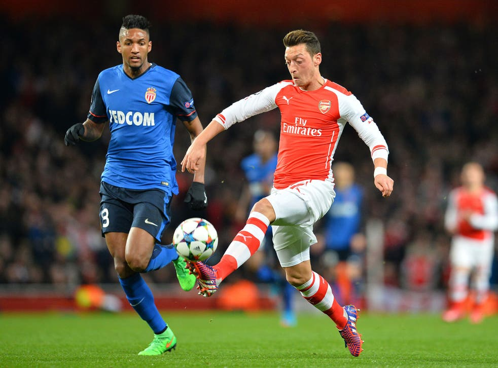 Wallace marks Mesut Özil (right), who lost possession too often playing moderate passes