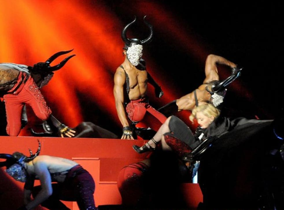 Madonna falls as she performs at the BRIT Awards 2015