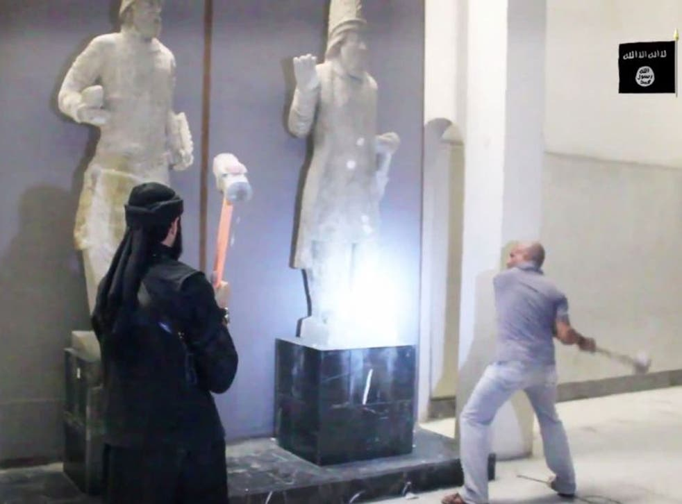Isis militants attack ancient artifacts with sledgehammers in the Ninevah Museum in Mosul, Iraq (AP)