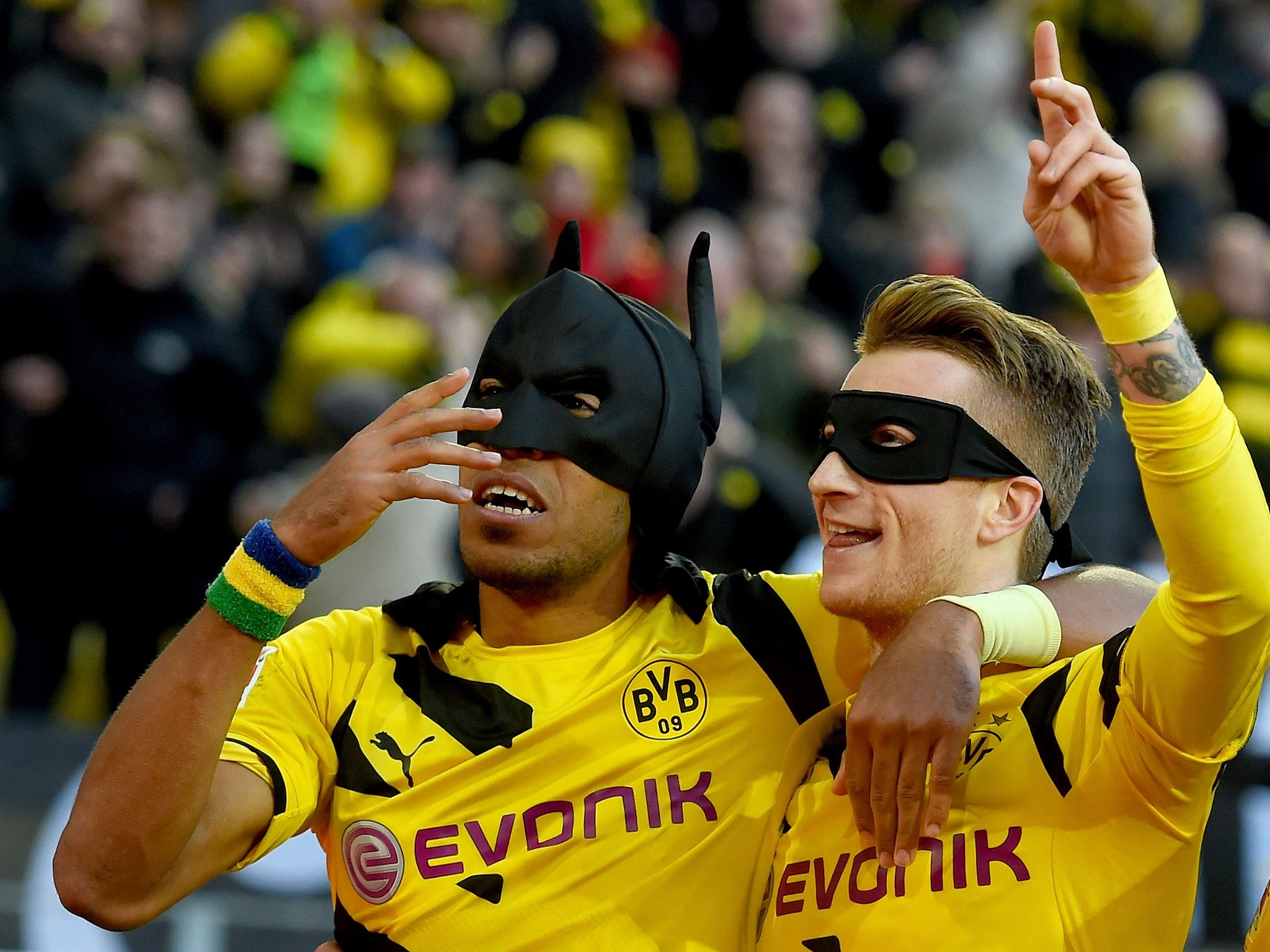 marco reus and pierre emerick aubameyang dress as batman and robin during borussia dortmund 39 s. Black Bedroom Furniture Sets. Home Design Ideas